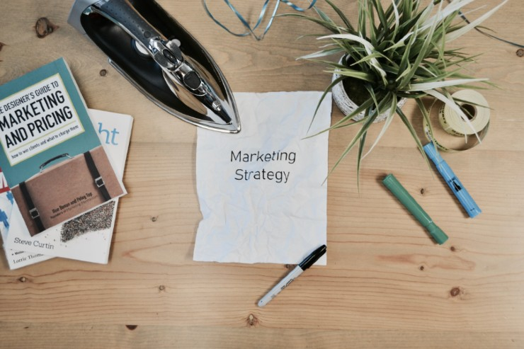 A piece of paper saying 'Marketing Strategy'